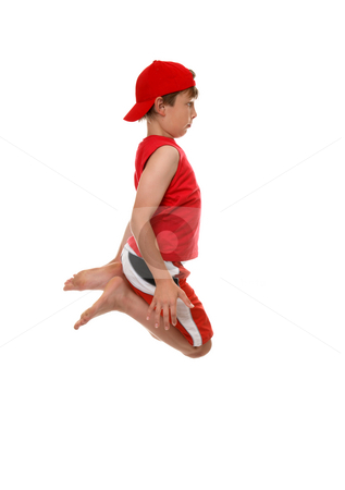 Jumping boy stock photo, A boy jumps into the air, knees in tight by Leah-Anne Thompson