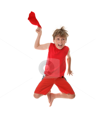 Boy with Zest for Life Leaping stock photo, A boy with zestful energy jumps high off the floor and takes off his hat. by Leah-Anne Thompson