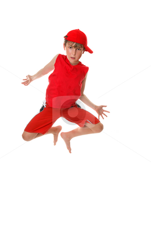 Child mid jump stock photo, A barefoot casual boy in mid jump by Leah-Anne Thompson
