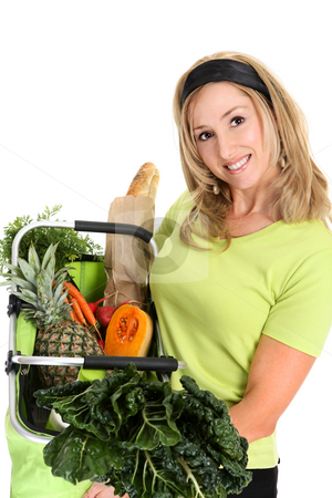 Woman displaying bag full of groceries stock photo, Fresh Healthy Produce.  A woman holds a basket full of fresh food items. by Leah-Anne Thompson