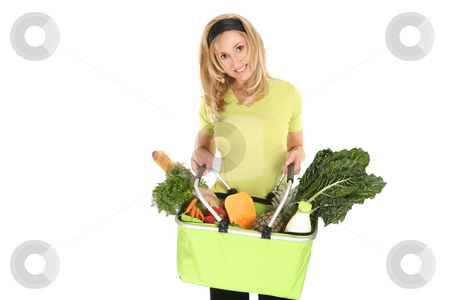 Shopping bag full of groceries stock photo, A girl holding an eco shopping bag holding a selection of milk, eggs, bread, fruit and vegetables by Leah-Anne Thompson