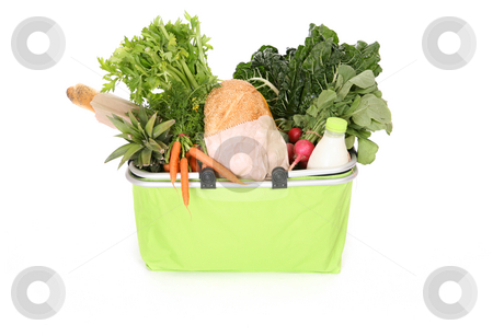 Food staples in eco shopping bag stock photo, Milk, bread, fruit and vegetables in an eco friendly shopping basket. by Leah-Anne Thompson