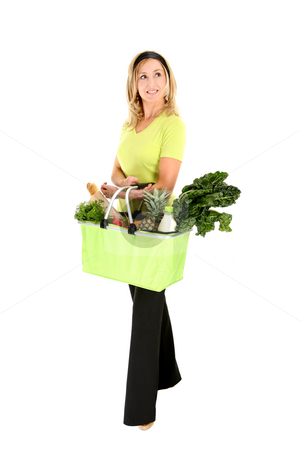 Eco aware shopper looking sideways stock photo, Eco shopper with basket of groceries looking sideways, space for copy by Leah-Anne Thompson