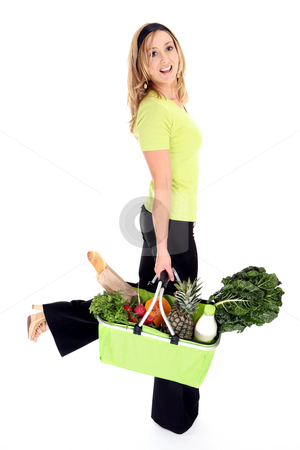 Eco friendly shopper stock photo, No more plastic bags.  Eco aware shopper using an eco friendly shopping bag full of natural fresh groceries milk and bread. Reusable bag folds flat when not in use. by Leah-Anne Thompson