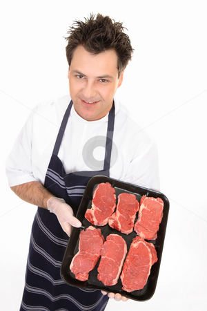 Butcher with tender steak stock photo, Butcher showing a tray of tender scotch filet steak. by Leah-Anne Thompson