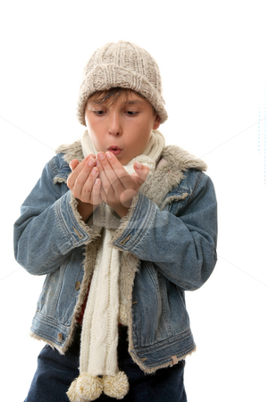 Keeping warm stock photo, Child blowing on hands to warm them up. by Leah-Anne Thompson