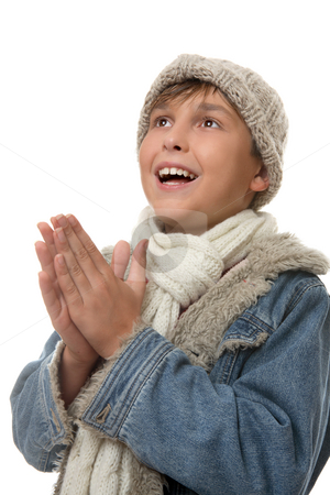 Boy hands together looking up stock photo, Young boy dressed in winter clothing looking up and smiling by Leah-Anne Thompson