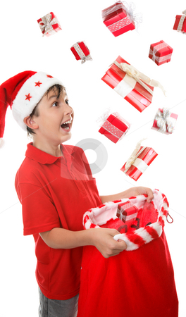 Sack full of presents stock photo, Lots of presents fall into a young boys Christmas sack to his delight. Some motion visible in presents. by Leah-Anne Thompson