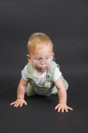 Baby stock photo, Baby Boy wearing a pastel dungaree and white shirt by Carla Booysen