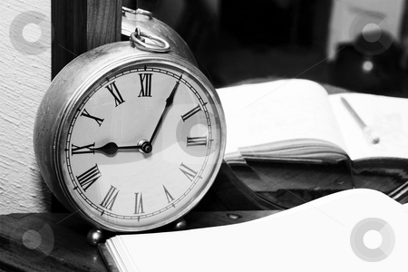 Clock stock photo, Old Style Clock standing next to a book by Carla Booysen