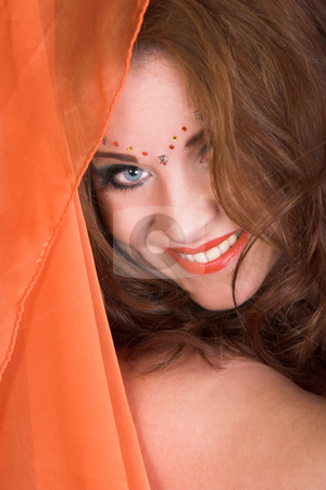 Belly Dancer with orange scarf stock photo, Belly Dancer wearing an orange costume with jewelery by Carla Booysen