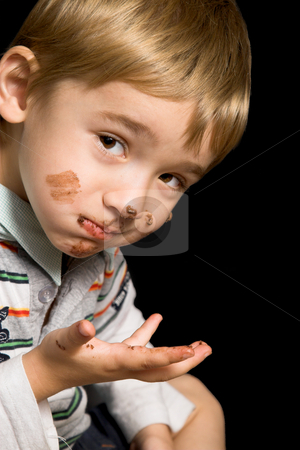 Chocolate Boy stock photo, Beautiful boy with brown eyes and a dirty mouth by Carla Booysen