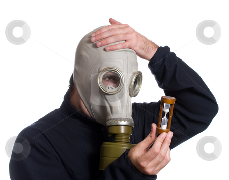 Out of Time stock photo, A man wearing a gas mask is looking at an hour glass realizing he is out of time, isolated against a white background by Richard Nelson