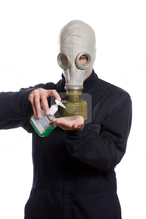 Hand Sanitizer stock photo, A young man wearing a breathing apparatus is using some hand sanitizer to keep germs away, isolated against a white background by Richard Nelson
