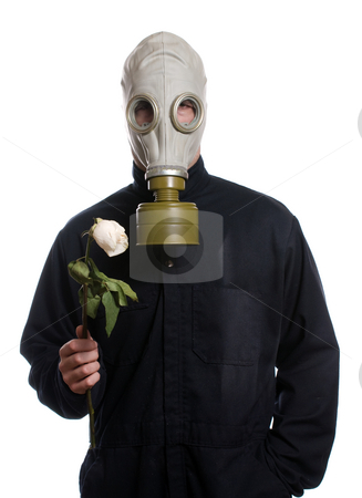 Environment Concept stock photo, Concept image of a man wearing a breathing apparatus and holding a flower, isolated against a white background by Richard Nelson