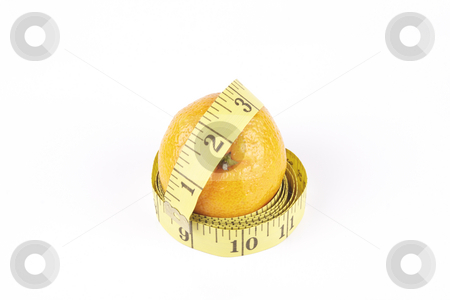Satsuma and Tape Measure stock photo, Small single satsuma with tape measure wrapped around on a reflective white background by Keith Wilson