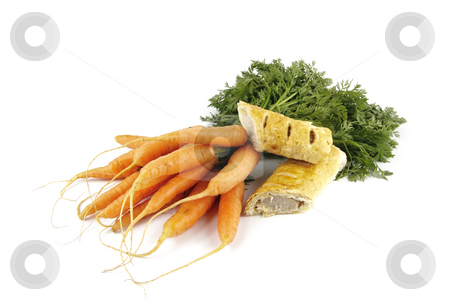 Carrots and Sausage Roll stock photo, Contradiction between healthy food and junk food using bunch of carrots and sausage roll on a reflective white background by Keith Wilson