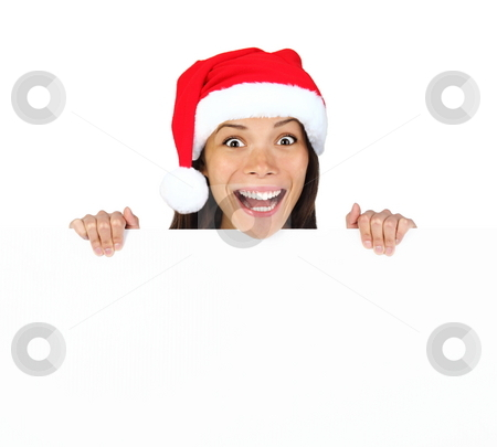 Christmas billbord woman stock photo, Christmas woman with billboard sign. Very beautiful mixed race asian / caucasian woman standing behind billboard looking happy and surprised at camera with funny expression. Isolated on white background. by Maridav