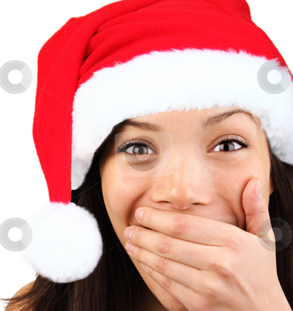 Happy surprised christmas woman  stock photo, Christmas girl very excited and surprised holding her mouth. Beautiful mixed asian / caucasian model. by Maridav