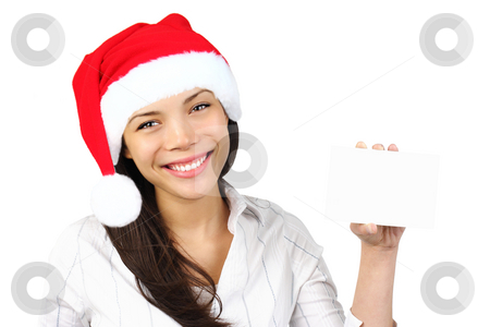 Christmas sign stock photo, Christmas sign.  Woman with santa hat holding blank paper sign. Very beautiful mixed race asian / caucasian woman smiling. Isolated on white background. by Maridav