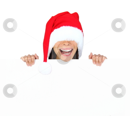 Funny christmas sign stock photo, Funny christmas woman with billboard sign. Woman with too big santa hat standing behind billboard with funny expression. Isolated on white background. by Maridav