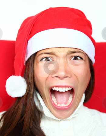 Screaming christmas woman with stress stock photo, Screaming christmas woman with santa hat. Beautiful mixed asian / caucasian model. by Maridav