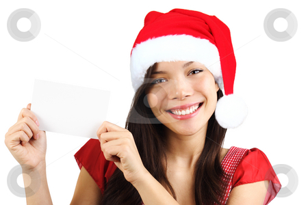Christmas woman holding blank paper sign stock photo, Christmas woman holding blank paper sign. Very beautiful mixed race asian / caucasian woman smiling. Isolated on white background. by Maridav
