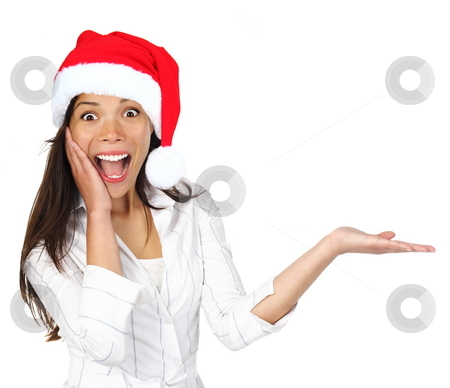 Christmas woman presenting product stock photo, Santa girl presenting your product with christmas hat. Beautiful young mixed asian / caucasian woman isolated on white. by Maridav