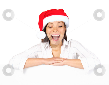 Christmas billbord sign woman stock photo, Christmas billbord sign woman. Beautiful mixed asian / caucasian woman leaning over blank billboard sign looking down being excited and surprised. Isolated on white background. by Maridav