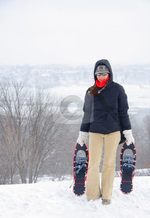 Woman with snowshoes stock photo, Snowshoes. Woman winter hiking with snowshoes on the Plains of Abraham, Quebec City, Canada. by Maridav