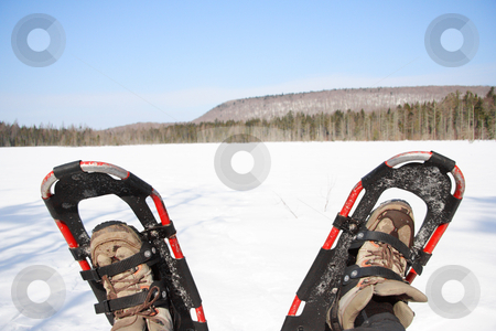 Snowshoes stock photo, Snowshoes from a winter hike by a frozen lake in Quebec, Canada. by Maridav