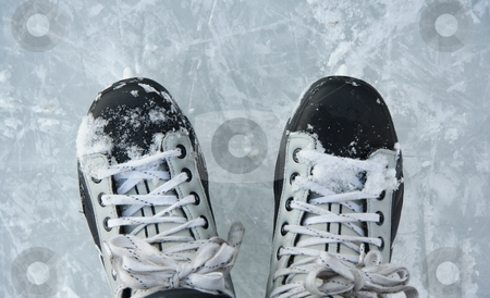 Ice skates stock photo, Closeup hockey ice skates in action outdoors. by Maridav