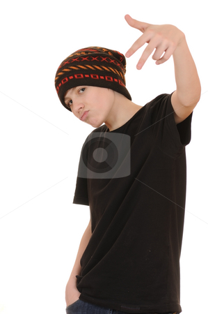 The teenager in a black vest and a hat stock photo, The teenager in a black vest and a hat isolated on white background by Salauyou Yury