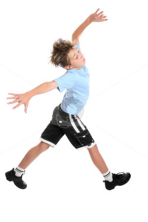 Striding boy stock photo, A boy taking gigantic strides by Leah-Anne Thompson