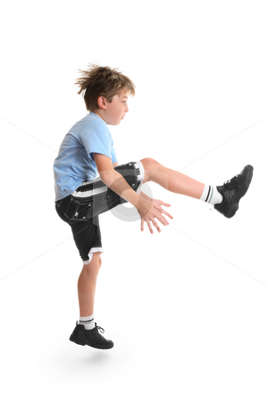 Fitness and Exercise stock photo, Healthy young child doing fitness exercises. by Leah-Anne Thompson