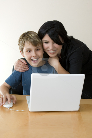 Adult and child enjoying computer time stock photo, Adult and child explore the internet or computer software, games, etc. by Leah-Anne Thompson