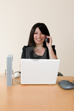 Wireless networking and voip stock photo, Emerging technologies - a woman using voip technology to make an internet phone call. by Leah-Anne Thompson
