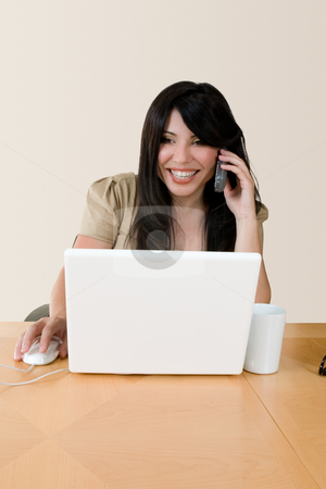 Business conversation stock photo, A woman at work using the telephone. by Leah-Anne Thompson