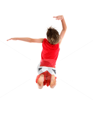 Boy jumping arms in grande pose. stock photo, An ecstatic  boy leaps with arms in a grande pose (second and third position) by Leah-Anne Thompson
