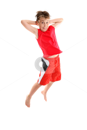 Boy jumping hands behind head stock photo, A boy jumping into air hands behind his head by Leah-Anne Thompson