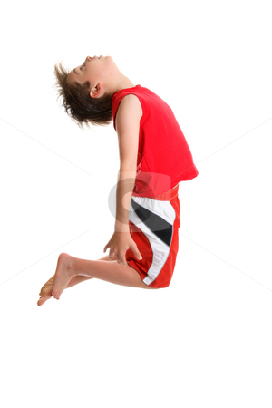 Jumping active boy stock photo, An energetic  boy jumps high and arches head back.  Some motion in hair. by Leah-Anne Thompson