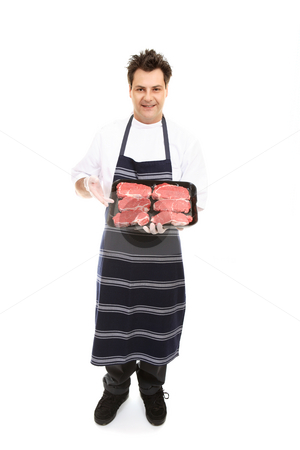 Butcher presenting meat cuts stock photo, A butcher presents some boneless meat cuts. by Leah-Anne Thompson