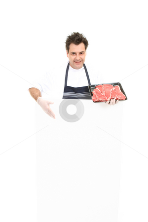 Butcher with advertising sign stock photo, Butcher presenting an advertising sign or specials board. by Leah-Anne Thompson