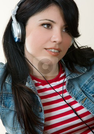 Music Girl stock photo, Female listening to music through headphones. by Leah-Anne Thompson