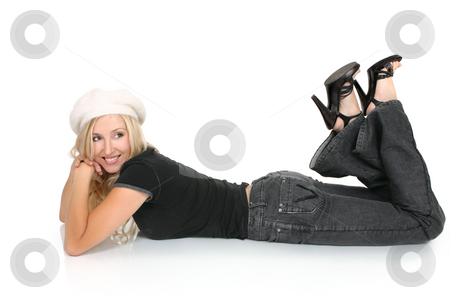 Woman lying on floor stock photo, Relaxed woman wearing jeans and t-shirt lying on the floor by Leah-Anne Thompson