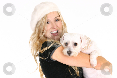 Smiling female holding a dog in her arms stock photo, Smiling woman carrying a small dog in her arms. by Leah-Anne Thompson