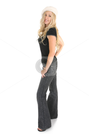 Casual woman in jeans stock photo, Casual blonde female dressed in charcoal bootleg jeans with leather trim on side seams and pocket with a casual t-shirt, standing in high heels and smiling in a friendly manner. by Leah-Anne Thompson