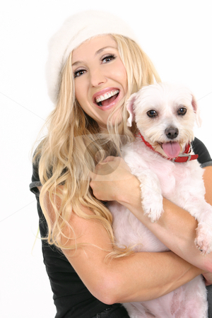 Laughing girl with puppy dog stock photo, Laughing female holding a cute small white dog by Leah-Anne Thompson