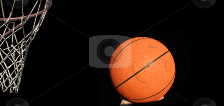 Basket with smiling basketball in hand stock photo, Isolated basketball with face before throw by Reinhart Eo