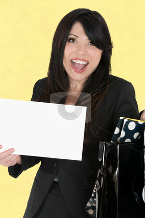 Happy woman holding a sign stock photo, Happy woman holding a sign and bags by Leah-Anne Thompson